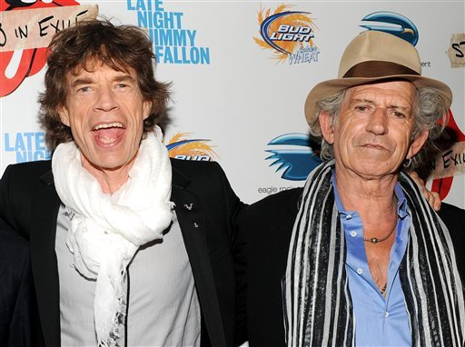"musicians Mick Jagger, left, Keith Richards of The Rolling Stones attends a special screening of their new documentary ""Stones In Exile""  (AP Photo/Evan Agostini, File)."