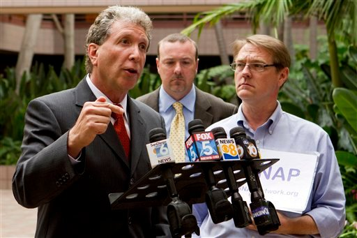 Attorney Irwin Zalkin, left, alongside SNAP National Director David Clohessy, right, and Anthony De Marco, speaks with members of the media during a news conference Sunday, Oct. 24, 2010, in San Diego. (AP Photo/Chris Park)