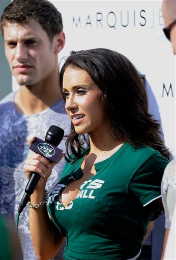 In this photo taken on Sunday, Sept. 14, 2008, Jenn Sterger works on the sideline before the New York Jets play the New England Patriots in an NFL football game at Giants Stadium in East Rutherford, N. J.
