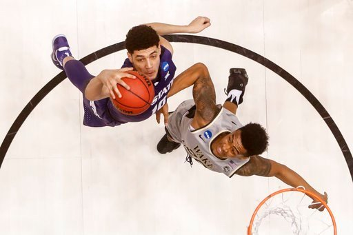 Kansas State's Isaiah Maurice, left, and Wake Forest's John Collins, right, battle for a rebound in the first half of a First Four game of the NCAA college basketball tournament, Tuesday, March 14, 2017, in Dayton, Ohio.