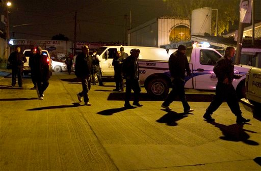 According to the police at the crime scene, at least 13 people were killed. (AP Photo/Guillermo Arias)