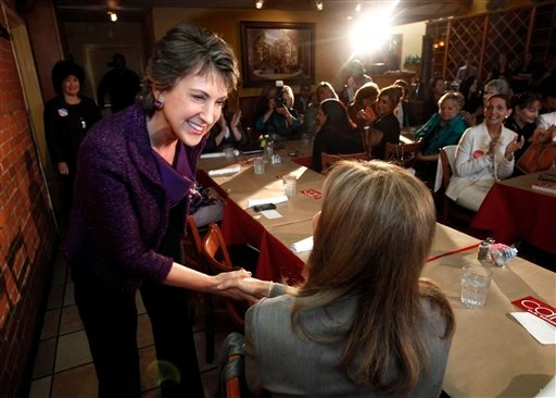 Republican U.S. Senate candidate Carly Fiorina, left, shakes hands with Sacramento County District Attorney Jan Scully, during a campaign stop in Sacramento, Calif., Oct. 19, 2010.(AP Photo/Rich Pedroncelli)