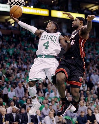 Boston Celtics guard Nate Robinson, left, drives to the basket past Miami Heat forward LeBron James, right, during the first half of an NBA basketball game in Boston, on Tuesday, Oct. 26, 2010.(AP Photo/Charles Krupa)