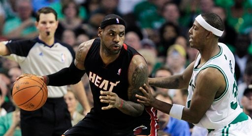 Boston Celtics forward Paul Pierce, right, defends against Miami Heat forward LeBron James, left, during the first half of an NBA basketball game in Boston, on Tuesday, Oct. 26, 2010.(AP Photo/Charles Krupa)