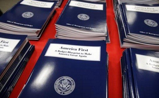 Copies of President Donald Trump's first budget are displayed at the Government Printing Office in Washington.