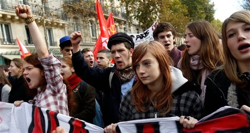 Students shout slogans during a demonstration in front of the Senate in Paris, Tuesday, Oct. 26, 2010. (AP Photo/Christophe Ena)