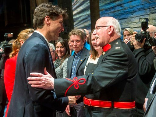 """Canadian Prime Minister Justin Trudeau, left, and his wife Sophie Gregoire, behind, greet some of the citizens from Gander, Newfoundland, after the Broadway musical """"Come From Away"""" in New York. (Ryan Remiorz/The Canadian Press via AP)"""
