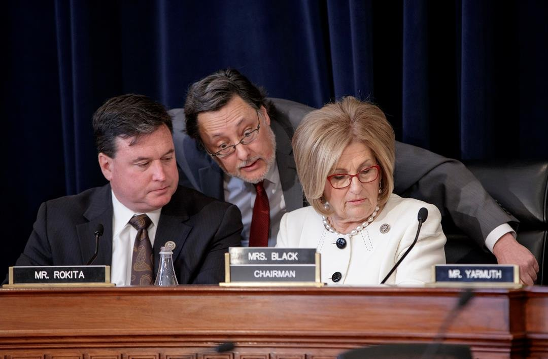 House Budget Committee Chair Diane Black, R-Tenn., right, joined at left by Rep. Todd Rokita, R-Ind., and panel staff member Jim Bates, center, works on the Republican health care bill, on Capitol Hill in Washington, Thursday, March, 16, 2017. (AP Photo/J
