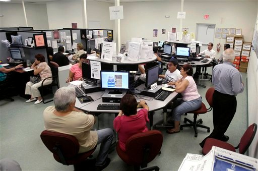In this photo taken Sept. 2, 2010, job seekers use computers as they seek employment at the South Florida Workforce office in Hialeah Gardens, Fla. (AP Photo/Alan Diaz)