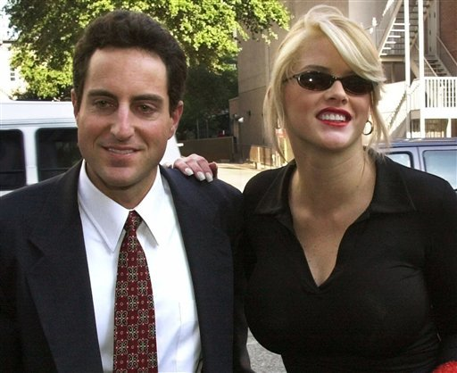 FILE - In this Oct. 2, 2000 file photo, Anna Nicole Smith, right, smiles as she walks to the courthouse with her attorney Howard K. Stern in Houston.