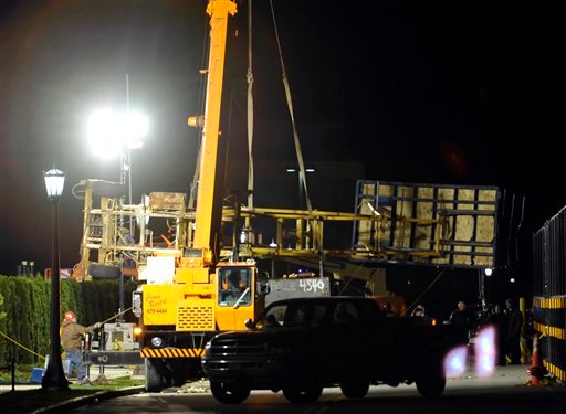 A crane lifts a video tower Thursday Oct. 28, 2010, at the football practice field at Notre Dame in South Bend, Ind.