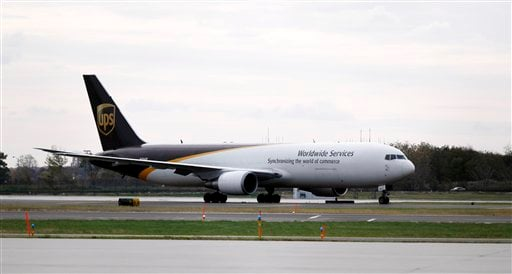 A United Parcel Service jet is seen isolated on a runway at Philadelphia International Airport in Philadelphia, Friday, Oct. 29, 2010. (AP Photo/Matt Rourke)