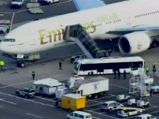 In this frame grab taken from WABC-TV video, passengers disembark an Emirates airliner into an awaiting bus at John F. Kennedy International Airport in New York, Friday Oct. 29, 2010.