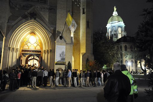 Notre Dame students enter the Basilica of the Sacred Heart for a Mass of Remembrance, Thursday, Oct. 28, 2010, in South Bend, Ind. (AP Photo/Joe Raymond)