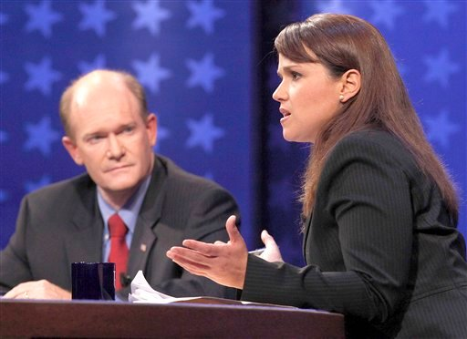 In this Oct. 13, 2010, file photo, Delaware Republican Senate candidate Christine O'Donnell answers a question as Democratic candidate Chris Coons listens at left, during a televised Delaware Senate debate at the University of Delaware in Newark, Del.