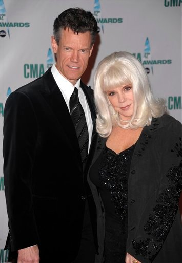 FILE - In this Nov. 12, 2008 file photo, country singer Randy Travis and his wife Elizabeth arrive at the 42nd Annual CMA Awards in Nashville, Tenn. (AP Photo/Peter Kramer, file)