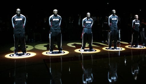 Miami Heat's starting five, from left to right Joel Anthony, LeBron James, Dwyane Wade, Chris Bosh and Carlos Arroyo, stand during pregame festivities of an NBA basketball game against the Orlando Magic, Friday, Oct. 29, 2010, in Miami. (AP Photo)