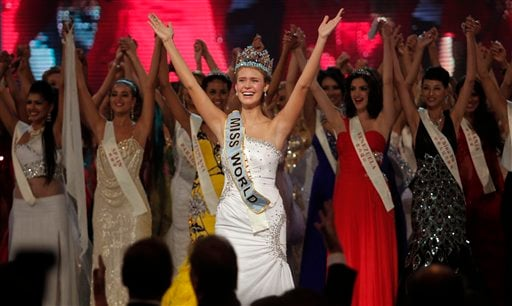 Miss USA Alexandria Mills, front center, gestures with other contestants after being crowned the winner of the 2010 Miss World pageant contest at the Beauty Crown Cultural Center. (AP Photo/Alexander F. Yuan)