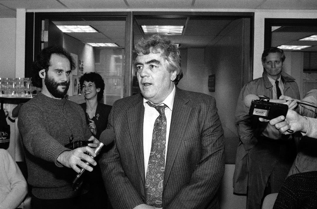 A 1986 file photo showing Jimmy Breslin of the New York Daily News, speaking to reporters after winning the Pulitzer prize for commentary, in the newsroom of the newspaper in New York. (AP Photo/Mario Cabrera, File)