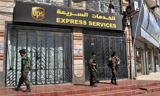 Yemeni security forces stand outside the UPS office in the capital San'a, Yemen Sunday, Oct. 31, 2010.  (AP Photo)