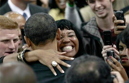 A woman gives President Barack Obama a hug as he makes a final get-out-the-vote push for Democratic candidates during a rally at Cleveland State University, in Cleveland, Sunday, Oct. 31, 2010. (AP Photo/J. Scott Applewhite)