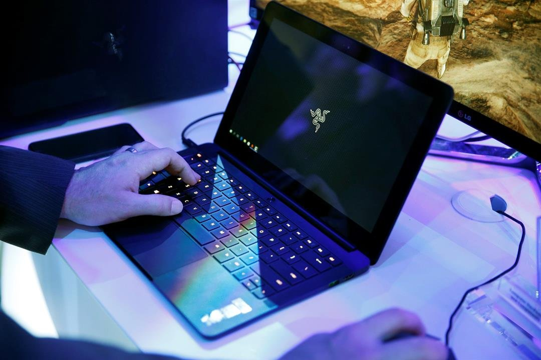 FILE - In this Jan. 7, 2016 file photo, a laptop is seen in Las Vegas. Royal Jordanian Airlines is advising passengers that laptops, iPads, cameras and other electronics won't be allowed in carry-on luggage for U.S.-bound flights starting Tuesday, March 2