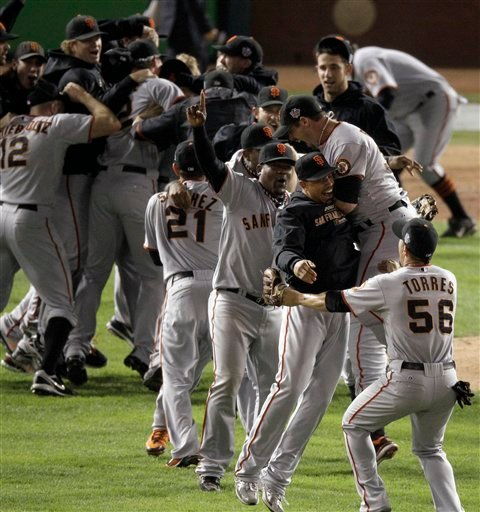 San Francisco Giants celebrate after winning baseball's World Series against the Texas Rangers 3-1 Monday, Nov. 1, 2010, in Arlington, Texas. (AP Photo/Eric Gay)