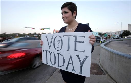 University of Texas junior Melissa Cantrell, of Aubrey, Texas, holds a sign reminding people to vote in Austin, Texas, Tuesday, Nov. 2, 2010. (AP Photo/LM Otero)