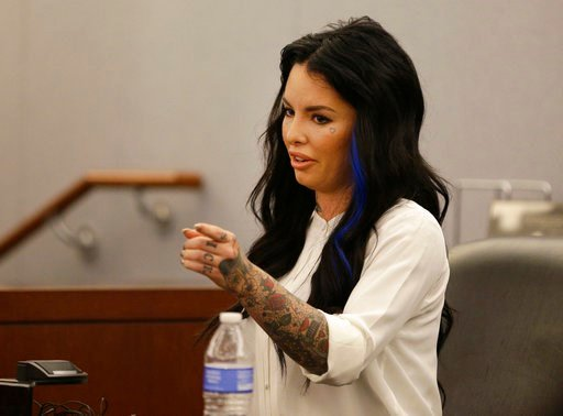 In this Nov. 14, 2014, file photo, Christine Mackinday, also known as Christy Mack, points toward Jonathan Paul Koppenhaver, also known as War Machine, during a preliminary hearing for Koppenhaver.
