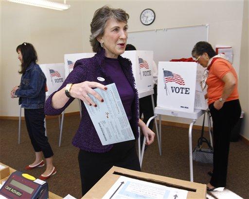 California Republican Senate Carly Fiorina casts her ballot at a polling place in Los Altos Hills, Calif., Tuesday, Nov. 2, 2010. Fiorina, the former CEO of Hewlett-Packard, is running against incumbent Sen. Barbara Boxer, D-Calif. (AP Photo/Paul Sakuma)