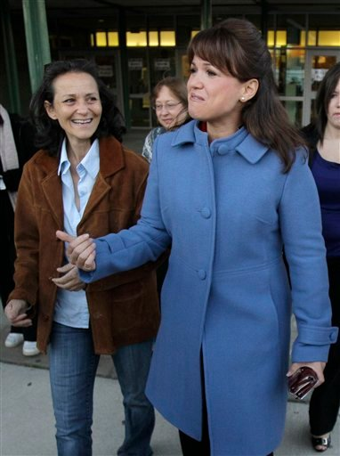 Delaware Republican U.S. Senate candidate Christine O'Donnell walks out after voting with her sister Jennie O'Donnell, left, after voting Tuesday, Nov. 2, 2010, in Wilmington, Del. O'Donnell is facing Democrat Chris Coons. (AP Photo/Rob Carr)