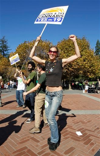 California Proposition 19, the legalization of marijuana initiative, supporter Sylvia Bagge dances during a rally at Sproul Plaza on the University of California, Berkeley campus in Berkeley, Calif., Monday, Nov. 1, 2010. The rally was sponsored by the St