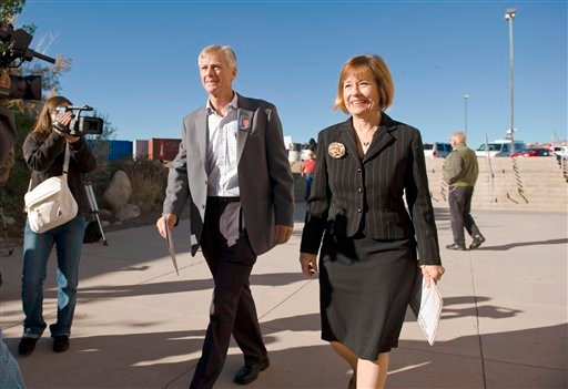 Nevada Republican Senate candidate Sharron Angle, and her husband Ted, walk into their polling place to vote, Tuesday, Nov. 2, 2010, in Reno, Nev. (AP Photo/Scott Sady)