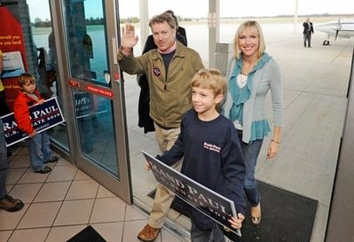 Republican candidate for U.S. Senate Rand Paul, from left, his son Robert Paul, 10, and his wife Kelley Paul wave to supporters as they enter the Bowling Green-Warren County Regional Airport during a campaign stop in Bowling Green, Ky. on Nov. 1, 2010.