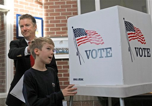 Kentucky Republican Senate candidate Rand Paul rubs the head of his 11-year-old son Robert after filling out his ballot in Bowling Green, Ky., Tuesday, Nov. 2, 2010. (AP Photo/Ed Reinke)