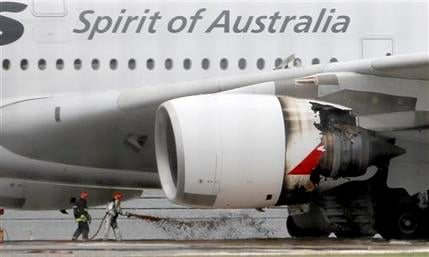 Firefighters surround a Qantas passenger plane which made an emergency landing with 459 people aboard in Singapore's Changi International Airport after having engine problems Thursday, Nov. 4, 2010. (AP Photo/Wong Maye-E)