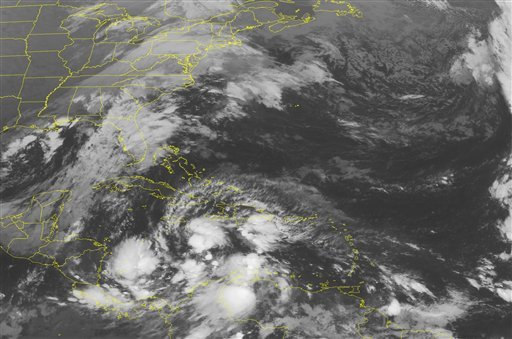 This NOAA satellite image taken Thursday, Nov. 4, 2010 at 4:45 a.m. EDT shows a mass of clouds in the Caribbean Sea associated with tropical system Tomas.