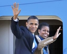 President Barack Obama and first lady Michelle Obama wave as they board Air Force One at Andrews Air Force Base, Md., Friday, Nov. 5, 2010, for a 10-day trip through India, Indonesia, South Korea and Japan, the longest foreign outing of Obama's presidency
