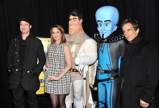 From left, actor Brad Pitt, actress Tina Fey and executive producer Ben Stller pose with Metro Man and Megamind characters at the 'Megamind' film premiere at on Wednesday, Nov. 3, 2010 in New York. (AP Photo/Evan Agostini)