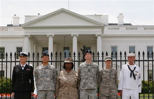 In this Tuesday, April 16, 2010 picture, memebers of the military stand together after they handcuffed themselves to the fence outside the White House in Washington during a protest for gay rights. (AP Photo/Pablo Martinez Monsivais)