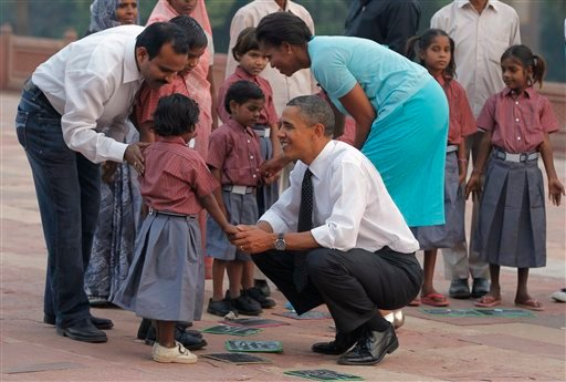 President Barack Obama and first lady Michelle Obama greet children of workers who restore historical sites as they visit Humayun's Tomb in New Delhi, India, Sunday, Nov. 7, 2010. (AP Photo/Charles Dharapak)