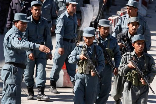 Afghan police forces arrived to secure area where the former legislators and there supporters march towards the US embassy during a protest against the September's parliamentary poll in Kabul, Afghanistan on Sunday, Nov 7, 2010.  (AP Photo/Musadeq Sadeq)