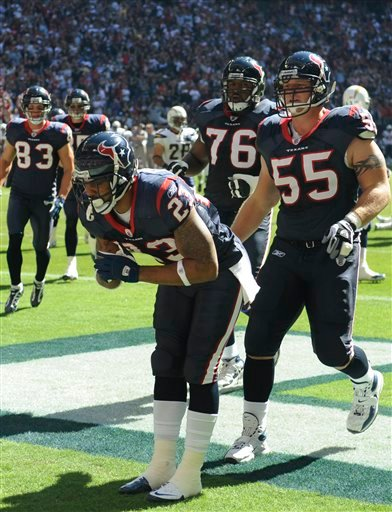 Houston Texans running back Arian Foster (23) celebrates his touchdown in the first quarter of an NFL football game against the San Diego Chargers Sunday, Nov. 7, 2010 in Houston. (AP Photo/Dave Einsel)