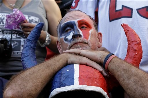 An unhappy Houston Texans fan watches the final minutes of the NFL football game against the San Diego Chargers Sunday, Nov. 7, 2010 in Houston. The Chargers won 29-23. (AP Photo/Eric Gay)
