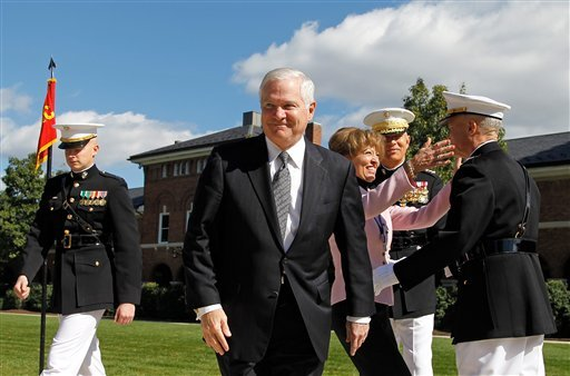 Defense Secretary Robert Gates smiles after presiding over the Passage of Command of the United States Marine Corps from Gen. James T. Conway, second from right, to Gen. James F. Amos, right, Friday, Oct. 22, 2010, at the Marine Barracks in Washington. AP