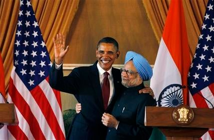 U.S. President Barack Obama, left, and Indian Prime Minister Manmohan Singh, embrace following a joint statement and press conference at Hyderabad House in New Delhi, India, Monday, Nov. 8, 2010. (AP Photo/Saurabh Das)