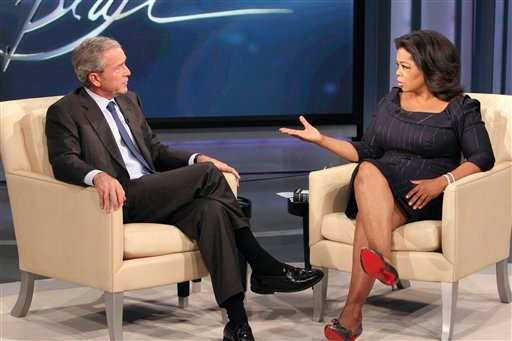 "This photo taken Oct. 28, 2010 and provided by Harpo Productions Inc., shows talk-show host Oprah Winfrey interviewing former President George W. Bush during taping of ""The Oprah Winfrey Show"" at Harpo Studios in Chicago."