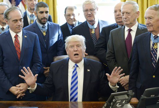 United States President Donald Trump meets with thirty Medal of Honor recipients in the Oval Office of the White House in Washington, DC. (Rex Features via AP Images)