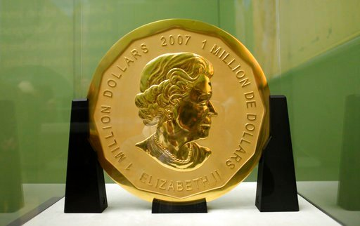 Dec. 12, 2010 file photo shows the gold coin 'Big Maple Leaf' in the Bode Museum in Berlin. The 100-kilogram (220 pound) gold coin disappeared from the museum. (Marcel Mettelsiefen/dpa via AP)