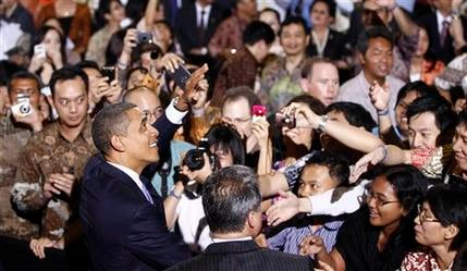 President Barack Obama greets the crowd after he speaks at the University of Indonesia in Jakarta, Indonesia, Wednesday, Nov. 10, 2010. (AP Photo/Charles Dharapak)